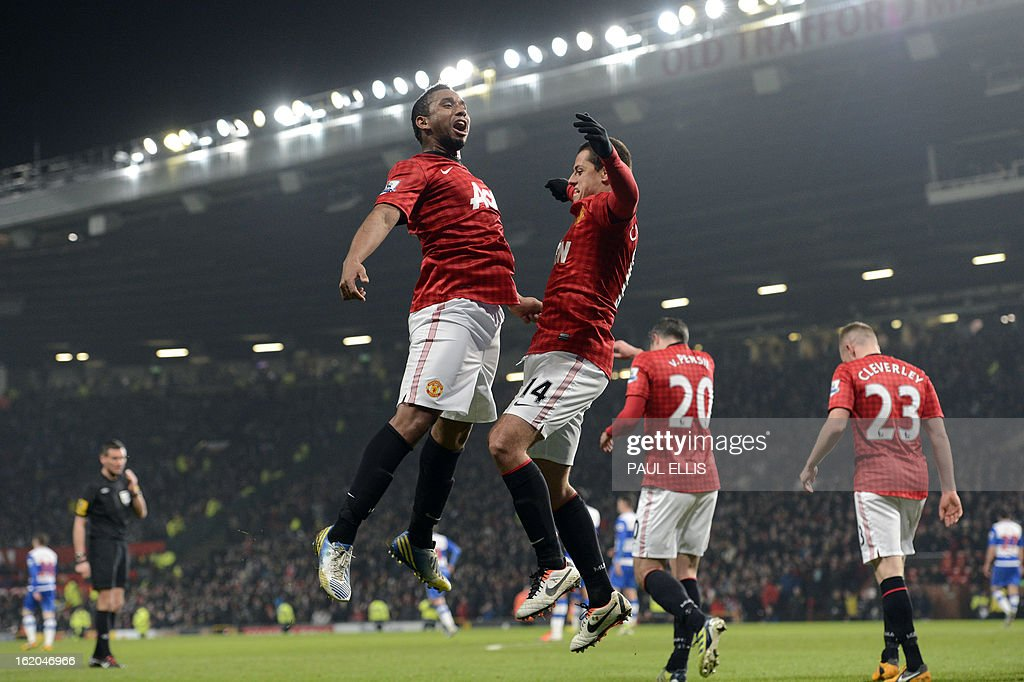 "Manchester United's Mexican striker Javier Hernandez (R) celebrates scoring his team's second goal with Manchester United's Brazilian midfielder Anderson (L) during the English FA Cup fifth round football match between Manchester United and Reading at Old Trafford in Manchester, north west England, on February 18, 2013. USE. No use with unauthorized audio, video, data, fixture lists, club/league logos or ""live"" services. Online in-match use limited to 45 images, no video emulation. No use in betting, games or single club/league/player publications."