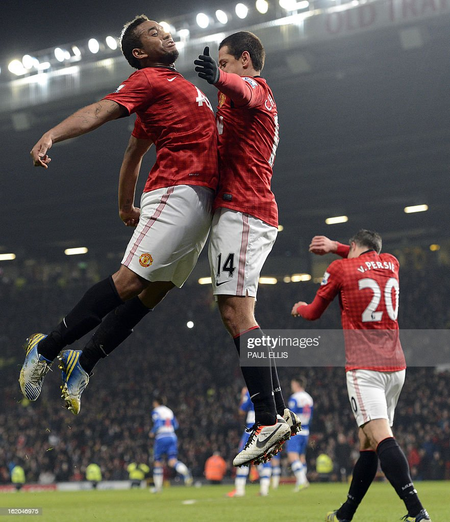 """Manchester United's Mexican striker Javier Hernandez (R) celebrates scoring his team's second goal with Manchester United's Brazilian midfielder Anderson (L) during the English FA Cup fifth round football match between Manchester United and Reading at Old Trafford in Manchester, north west England, on February 18, 2013. USE. No use with unauthorized audio, video, data, fixture lists, club/league logos or """"live"""" services. Online in-match use limited to 45 images, no video emulation. No use in betting, games or single club/league/player publications."""