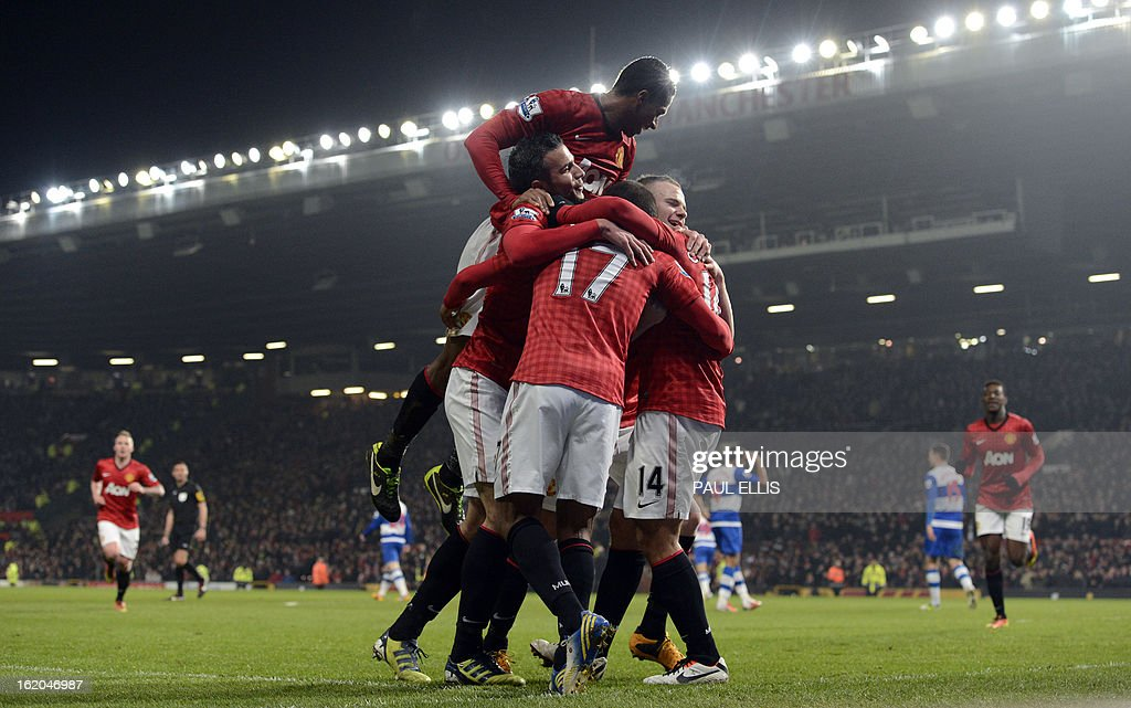 "Manchester United's Mexican striker Javier Hernandez is congratulated by teammates after scoring their second goal during the English FA Cup fifth round football match between Manchester United and Reading at Old Trafford in Manchester, north west England, on February 18, 2013. USE. No use with unauthorized audio, video, data, fixture lists, club/league logos or ""live"" services. Online in-match use limited to 45 images, no video emulation. No use in betting, games or single club/league/player publications."