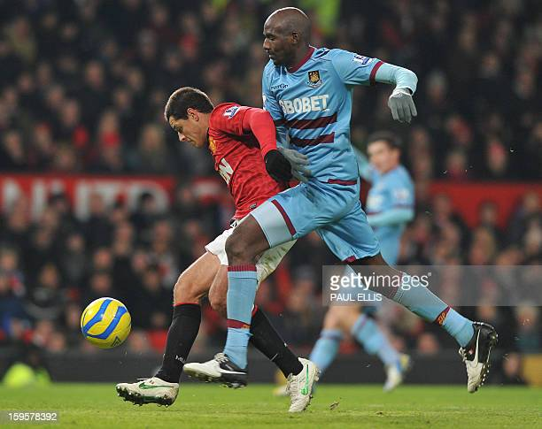 Manchester United's Mexican striker Javier Hernandez vies with West Ham United's French midfielder Alou Diarra during the English FA Cup third round...