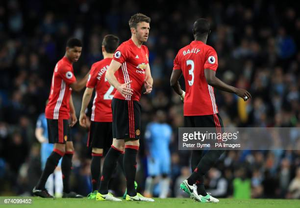 Manchester United's Michael Carrick and Eric Bailly speak prior to the start of the second half of the Premier League match at the Etihad Stadium...