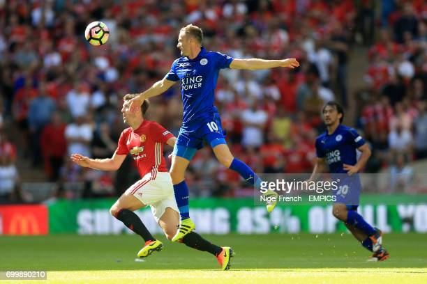 Manchester United's Michael Carrick and Leicester City's Jamie Vardy battle for the ball