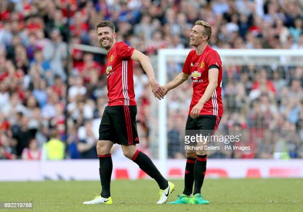 Manchester United's Michael Carrick has a joke with Darren Fletcher during Michael Carrick's Testimonial match at Old Trafford Manchester