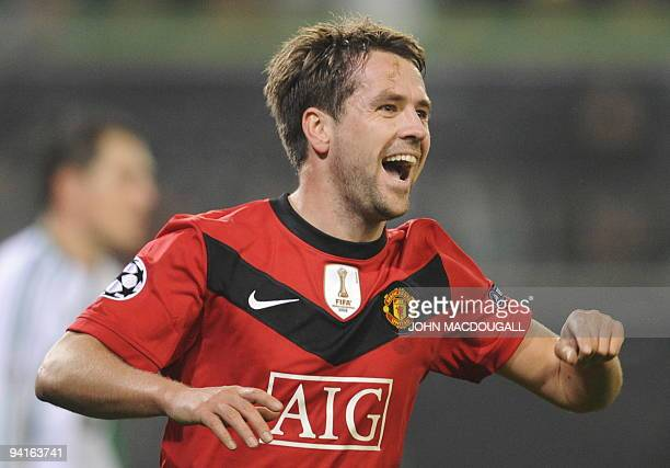 Manchester United's Michael Owen celebrates after scoring during the UEFA Champions League group B football match Wolfsburg vs Manchester United in...