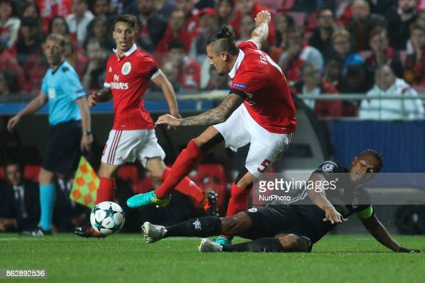 Manchester United's midfielder Antonio Valencia vies with Benfica's midfielder Ljubomir Fejsa during the Champions League football match between SL...