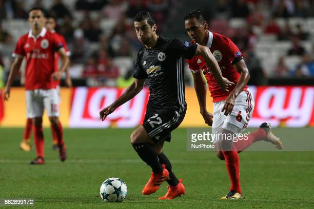 Manchester Uniteds midfielder Henrikh Mkhitaryan from Armenia and Benficas midfielder Filipe Augusto from Brazil during the match between SL Benfica...