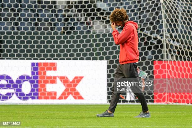 Manchester United's midfielder Marouane Fellaini attends a team training session at the club's training complex near Carrington west of Manchester in...