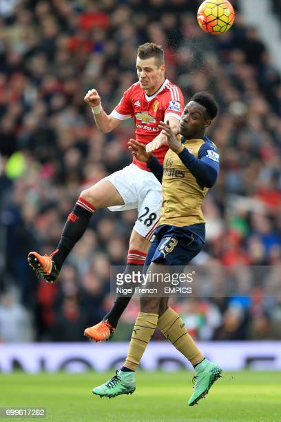 Manchester United's Morgan Schneiderlin and Arsenal's Danny Welbeck battle for the ball