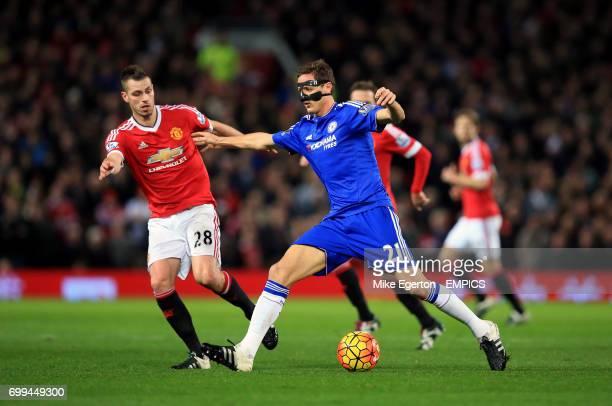 Manchester United's Morgan Schneiderlin and Chelsea's Nemanja Matic battle for the ball