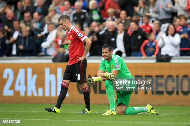 Manchester United's Morgan Schneiderlin and goalkeeper Sergio Romero appear dejected after Swansea City's second goal