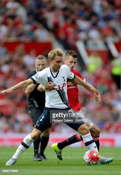 Manchester United's Morgan Schneiderlin and Tottenham's Christian Eriksen challenge