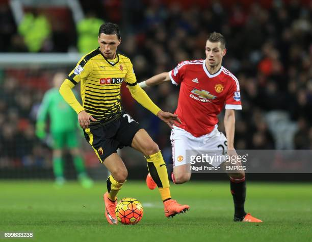 Manchester United's Morgan Schneiderlin and Watford's Jose Holebas battle for the ball