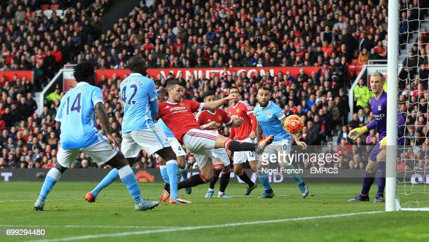 Manchester United's Morgan Schneiderlin misses a chance to score against Manchester City