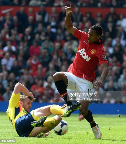 Manchester United's Nani battles for the ball with Sunderland's Lee Cattermole during the Barclays Premier League match at Old Trafford Manchester