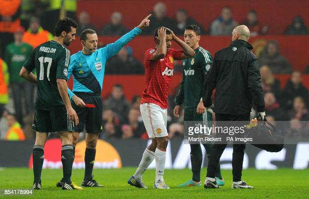 Manchester United's Nani is sent off after receiving a red card from referee Cuneyt Cakir during the UEFA Champions League match at Old Trafford...