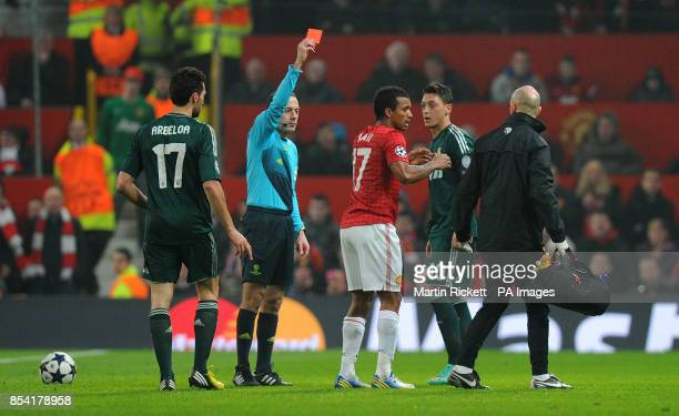 Manchester United's Nani receives a red card from referee Cuneyt Cakir during the UEFA Champions League match at Old Trafford Manchester