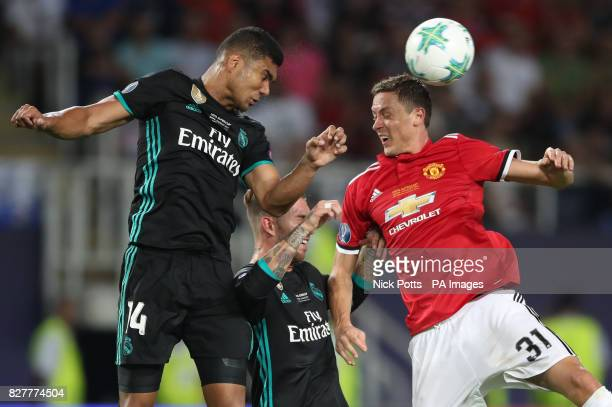 Manchester United's Nemanja Matic and Real Madrid's Casemiro battle for the ball in the air during the UEFA Super Cup match at the Philip II Arena...