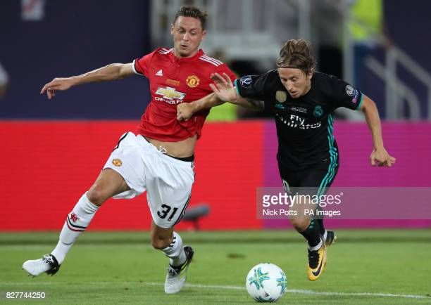 Manchester United's Nemanja Matic and Real Madrid's Luka Modric battle for the ball during the UEFA Super Cup match at the Philip II Arena Skopje...