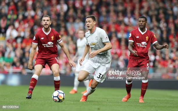 Manchester United's Nemanja Matic drives at the Liverpool defence during the Premier League match between Liverpool and Manchester United at Anfield...