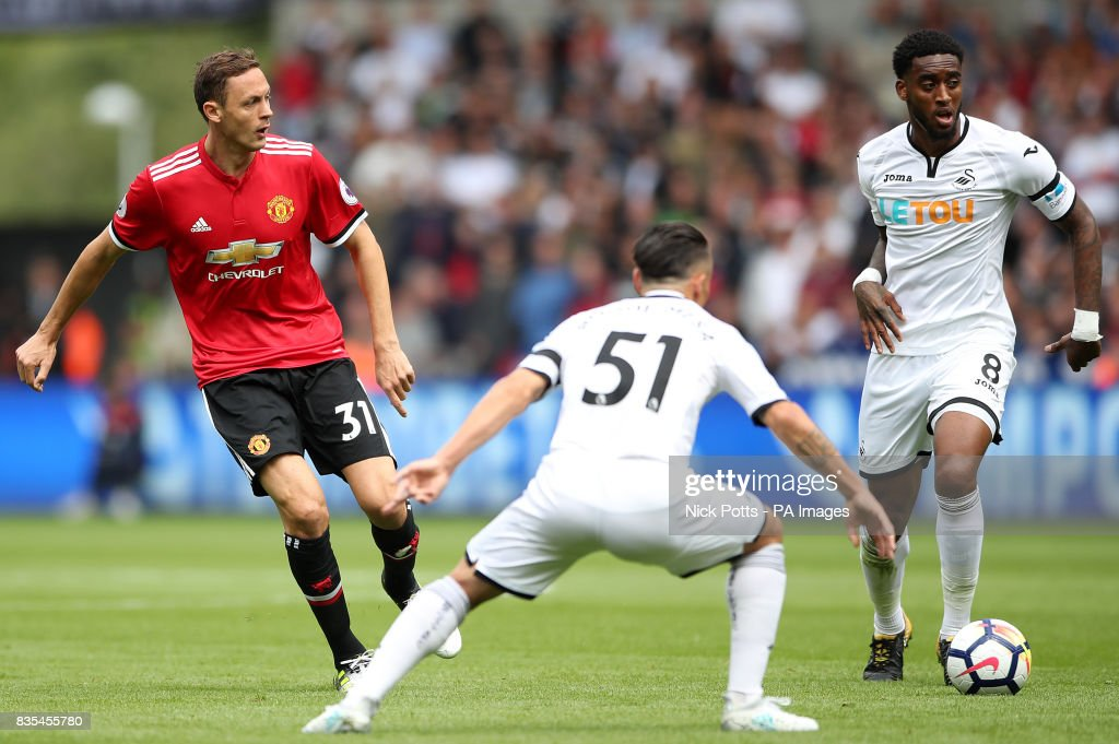 Manchester United's Nemanja Matic (left) in action with Swansea City's Leroy Fer (right) and Roque Mesa during the Premier League match at the Liberty Stadium, Swansea.