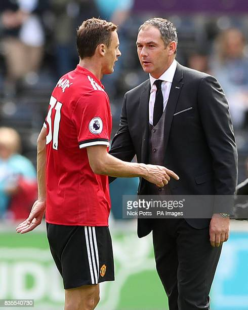 Manchester United's Nemanja Matic speaks with Swansea City manager Paul Clement after the Premier League match at the Liberty Stadium Swansea