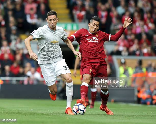 Manchester United's Nemanja Matic under pressure from Liverpool's Roberto Firmino during the Premier League match between Liverpool and Manchester...