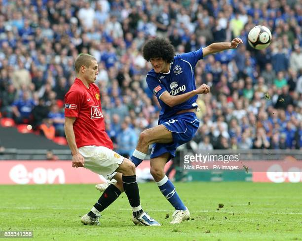 Manchester United's Nemanja Vidic blocks a shot by Everton's Marouane Fellaini