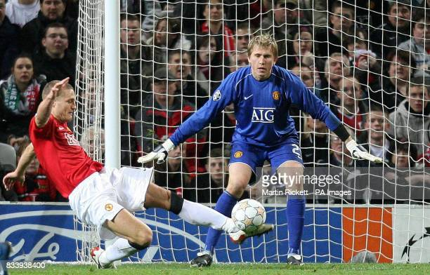 Manchester United's Nemanja Vidic clears from away from goalkeeper Thomasz Kuszczak during the UEFA Champions League match at Old Trafford Manchester