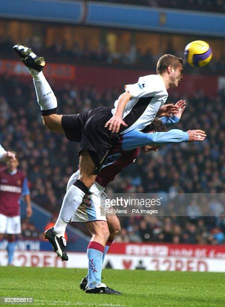 Manchester United's Nemanja Vidic clears the danger from Aston Villa's Chris Sutton
