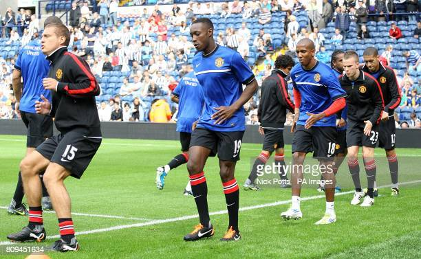 Manchester United's Nemanja Vidic Danny Welbeck Ashley Young Tom Cleverley and Chris Smalling warm up prior to kick off