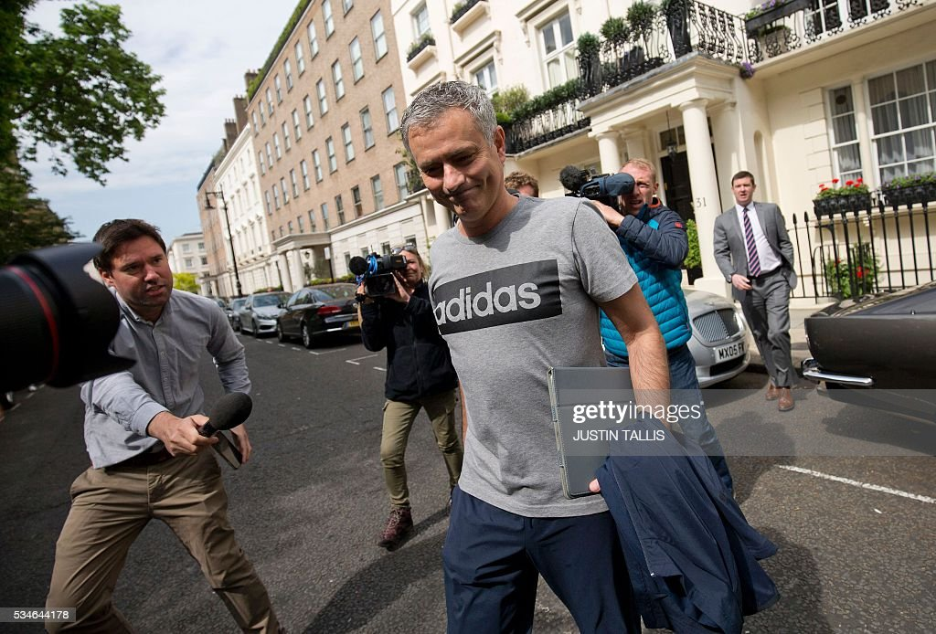 Manchester United's new Portuguese manager Jose Mourinho (C) leaves his home in central London on May 27, 2016. Manchester United on Friday anointed Jose Mourinho as their new manager to launch a third bid in less than three years to transform the Red Devils into a title-winning force again. After three days of talks, Mourinho agreed a three-year contract on a bumper salary reportedly worth more than $20 million (19.5 million euros) a year. / AFP / JUSTIN