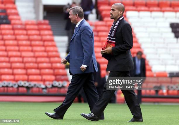 LEAGUE Manchester United's new signing Juan Sebastian Veron walks with manager Sir Alex Ferguson at Old Trafford Manchester Veron completed his...