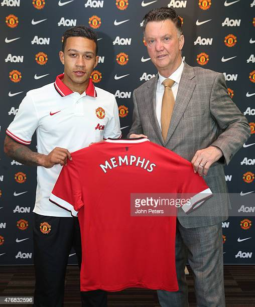 Manchester United's new signing Memphis Depay poses with his new manager Louis Van Gaal following the completion of his transfer at the Aon Training...