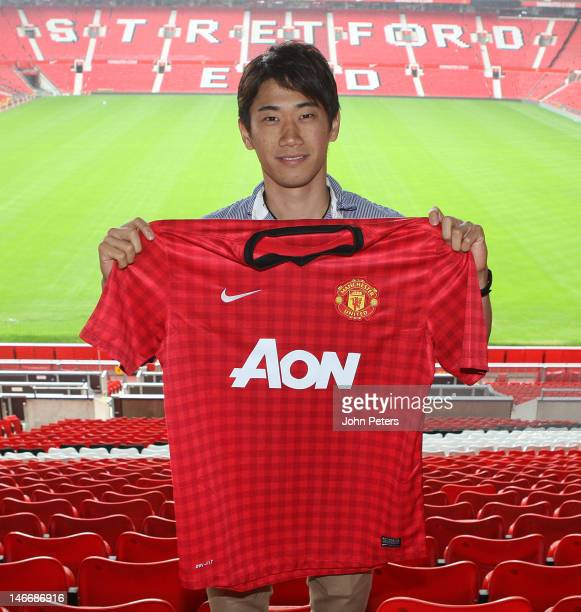 Manchester United's new signing Shinji Kagawa from Borussia Dortmund poses at Old Trafford on June 22 2012 in Manchester United Kingdom