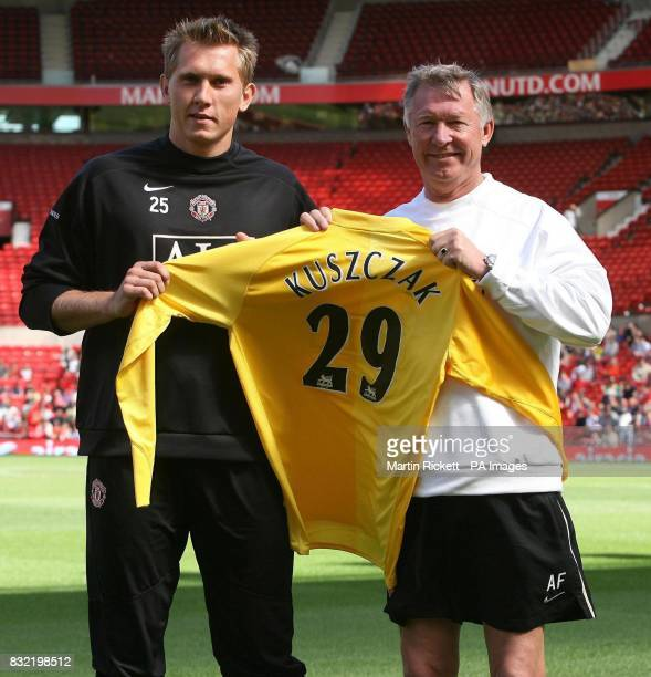 Manchester United's new signing Tomasz Kuszczak poses for photographers with Sir Alex Ferguson at Old Trafford Manchester