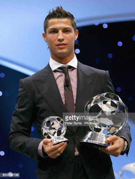 Manchester United's newly crowned UEFA Club Forward of the Year and UEFA Club Footballer of the Year Cristiano Ronaldo poses with his awards at the...