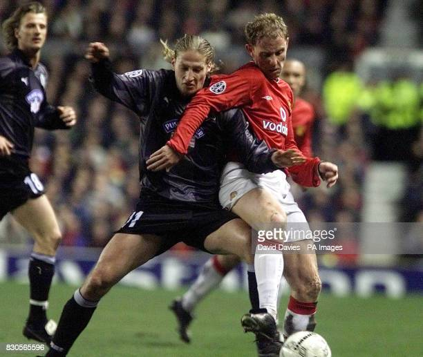 LEAGUE Manchester United's Nicky Butt holds off SK Sturm Graz's Gyorgy Korsos during the Champions League Group A game at Old Trafford Manchester