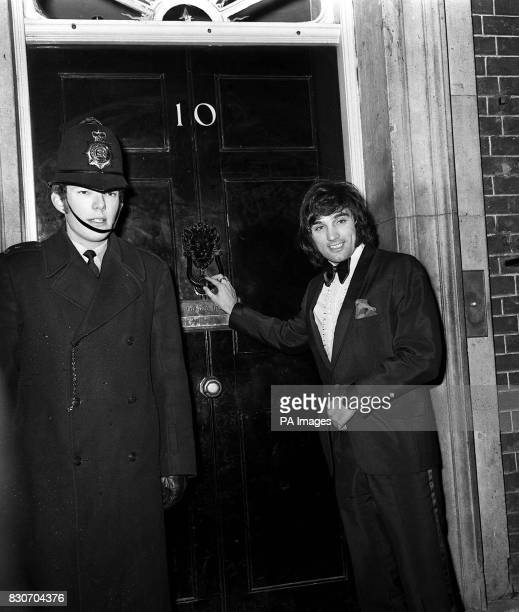 Manchester United's Northern Ireland international winger George Best knocks on the door of 10 Downing Street He was attending a reception given by...