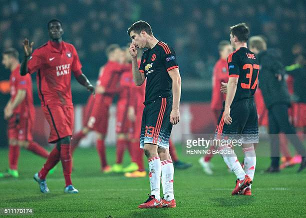 Manchester United's Northern Irish midfielder Paddy McNair reacts after the the UEFA Europa League Round of 32 football match between Manchester...