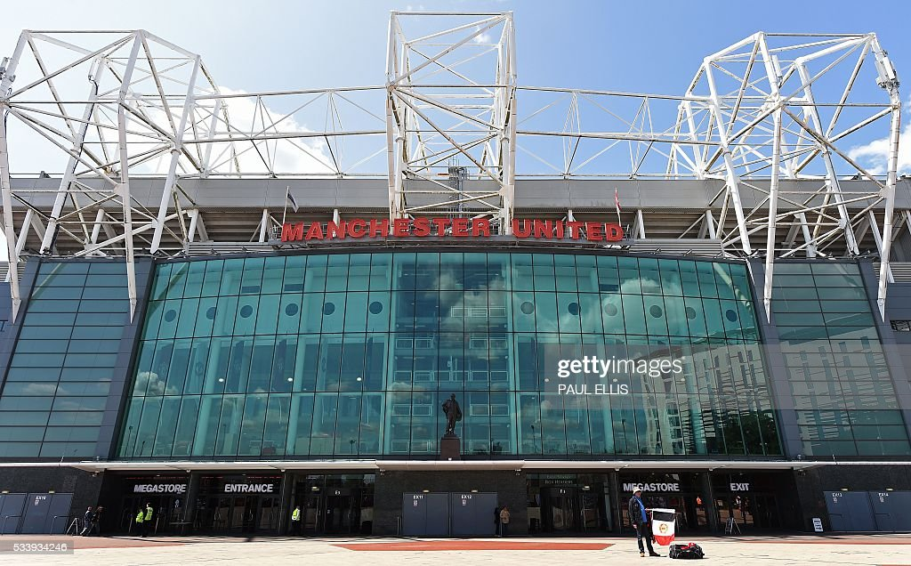 Manchester United's Old Trafford football stadium is pictured in Manchester, north-west England on May 24, 2016. Jose Mourinho was on the verge of fulfilling his dream of managing Manchester United on Tuesday after Louis van Gaal's troubled two-year reign came to a bitter end. The path was clear for the former Chelsea manager to be confirmed as the new United boss after Van Gaal was sacked Monday -- the price of failing to get one of the world's biggest clubs into the Champions League. ELLIS