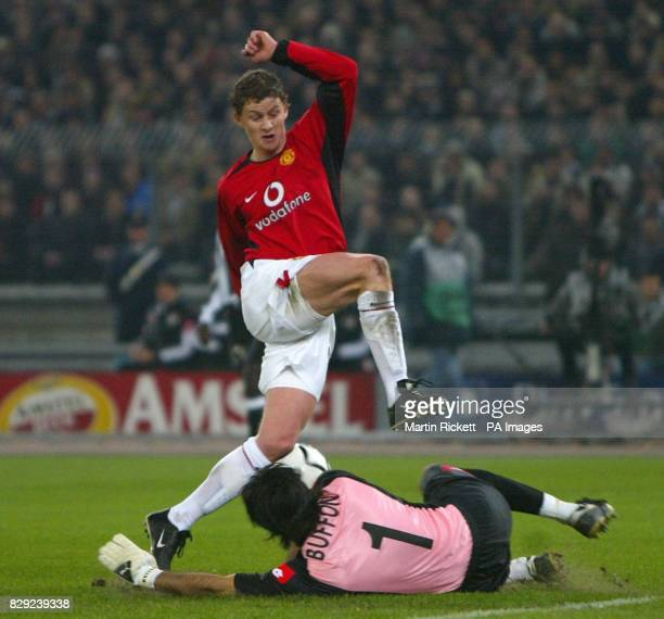 Manchester United's Ole gunnar Solskjaer is stopped by Juventus keeper Gianluigi Buffon during their Champions League group D phase 2 match at the...
