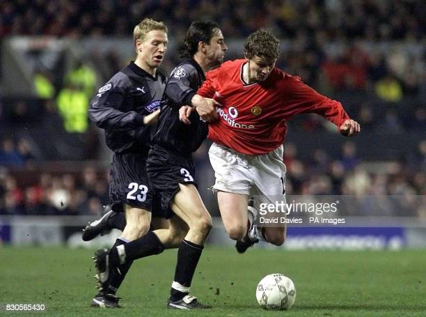 LEAGUE Manchester United's Ole Gunnar Solskjaer is tackled by SK Sturm Graz's Gunther Neukirchner during the Champions League Group A game at Old...