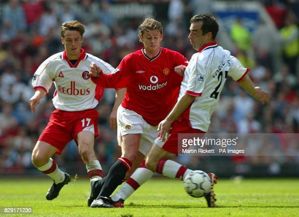 Manchester United's Ole Gunnar Solskjaer skips past Charlton Athletic's Jorge Costa watched by Scott Parker during the FA Barclaycard Premiership...