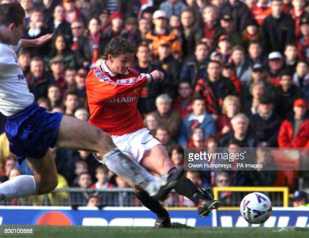 FEATURE Manchester United's Ole Gunner Solskjaer shoots to score Manchester's equalizer against Leeds United at Old Trafford today PHOTO OWEN...