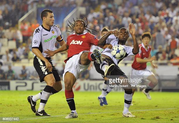 Manchester United's Oliveira Anderson battles Valencia's David Navarro and Luis Miguel for the ball