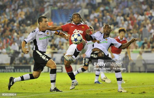 Manchester United's Oliveira Anderson battles Valencia's David Navarro and Luis Miguel for the ball during the the UEFA Champions League Group C...