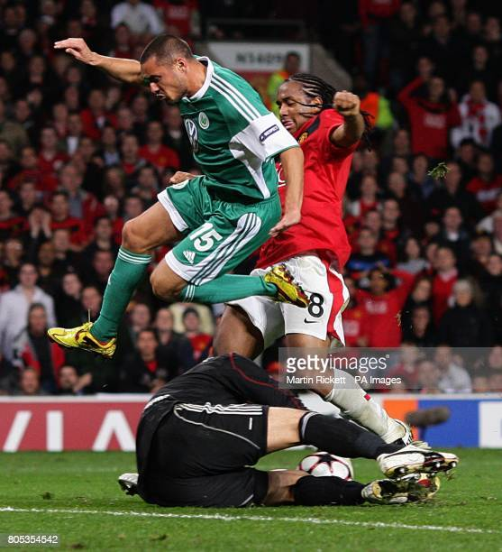 Manchester United's Oliveira Anderson battles Wolfsburg's Karim Ziani and Diego Benaglio for the ball