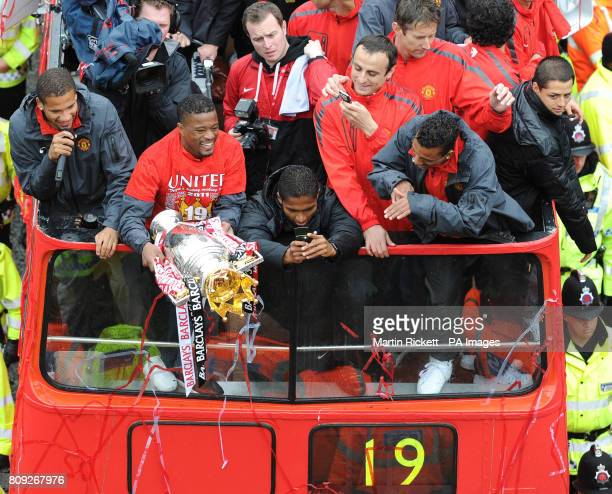 Manchester United's Patrice Evra Antonio Valencia Dimitar Berbatov and Luis Nani during the 2011 Barclays Premier League victory Parade through...