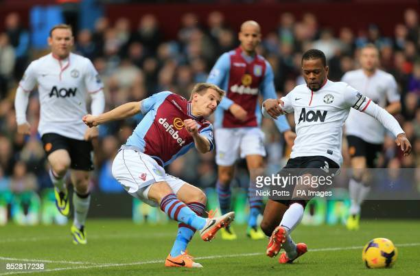 Manchester United's Patrice Evra attempts to block a shot from Aston Villa's Marc Albrighton