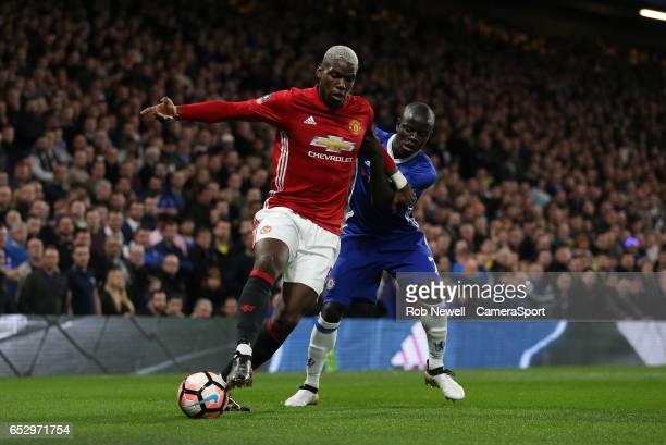 Manchester United's Paul Pogba and Chelsea's Ngolo Kante during the Emirates FA Cup QuarterFinal match between Chelsea and Manchester United at...
